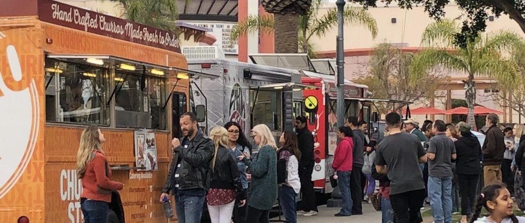 Crowds Enjoy Food at Plaza Park