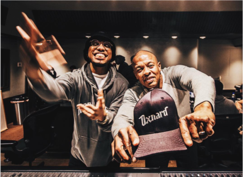 Dr Dre and Anderson Paak celebrating completion of album